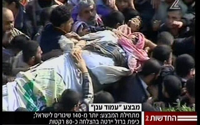 Palestinians in Gaza carry the body of slain Hamas military chief Ahmed Jabari on Thursday, November 15 (screen capture: Channel 2)