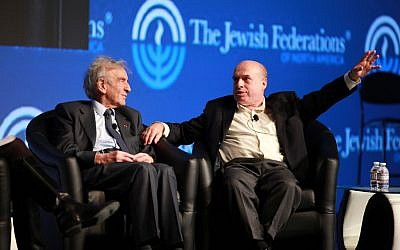 Nobel laureate Elie Wiesel, left, and Jewish Agency for Israel Chairman Natan Sharansky speak at the General Assembly of the Jewish Federations in North America last year. (David Karp/JTA)