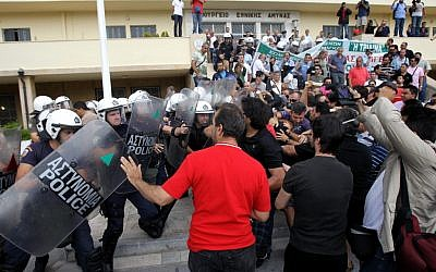 Riot police clash with protesters inside Greece's Defense Ministry in Athens on Oct. 4, 2012. (photo credit: Thanassis Stavrakis/AP)