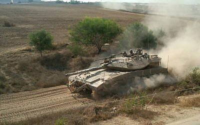 An IDF Merkava tank patrolling along the border with the Gaza Strip. (photo credit: Ilan Ben Zion/Times of Israel staff/File)