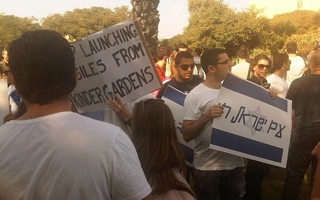 Students at Tel Aviv University hold signs in support of the IDF and Israel's southern residents, Wednesday (photo credit: Aaron Kalman)