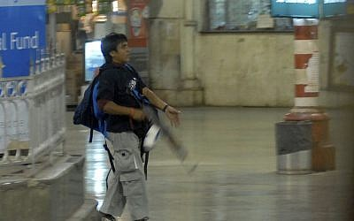 Mohammed Ajmal Kasab stalks a railway station in Mumbai during the 2008 terror attack