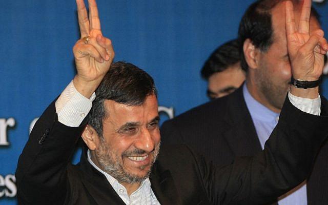 Iranian President Mahmoud Ahmadinejad makes peace gestures on the sidelines of the Bali Democracy Forum in Indonesia last November (photo credit: AP/Dita Alangkara)