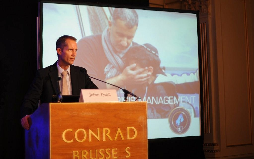 Johan Tynnel, the director of security for Denmark's Jewish community, addresses a European Jewish Congress crisis management seminar in Brussels. (Cnaan Liphshiz/JTA)