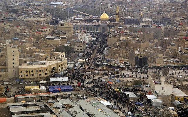 Shi'a and Sunni Muslims make their way to the Imam Husayn Shrine in Karbala, Iraq in 2008, during their pilgrimage in observance of the Arba'een and Ashura holidays. (photo credit: US Navy/Denny C. Cantrell via Wikimedia Commons)