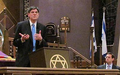 Obama surrogate Jack Lew makes a point during his debate with Romney surrogate Tevi Troy at Green Road Synagogue in Beachwood, Ohio, with moderator Nathan Diament listening in the background. (Ron Kampeas/JTA)