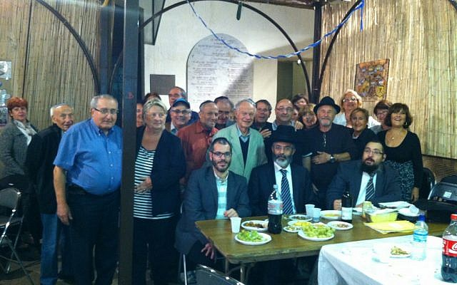 The staff of Marseille's Baskets for Shabbat charity gathers to raise funds during a special program on the city's Jewish radio station. (Courtesy of Paniers de Chabbat via JTA)