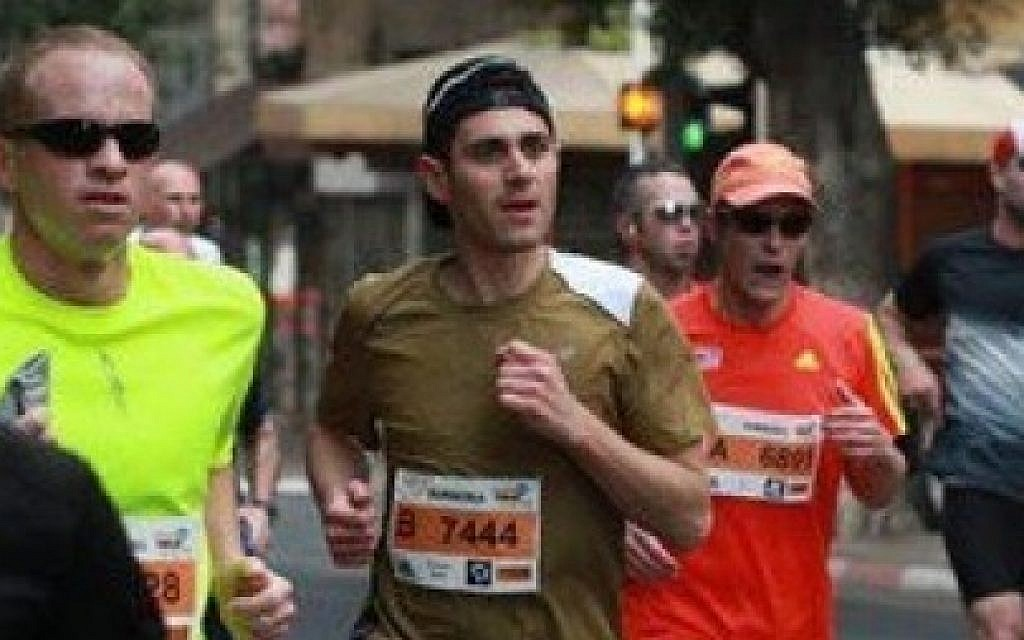 Matt Krieger runs the Tel Aviv half-marathon (photo credit: Courtesy)