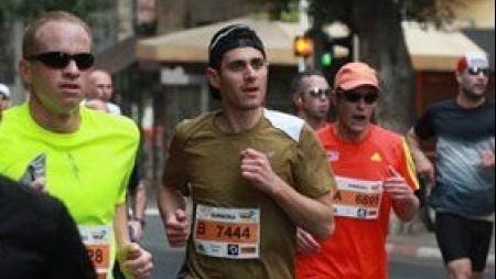 Matt Kreiger runs the Tel Aviv half-marathon (photo credit: Courtesy)