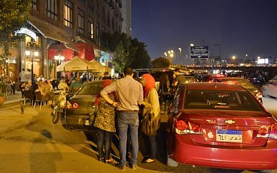 Egyptians congregate outside a Cairo cafe this week. (photo credit: AP)