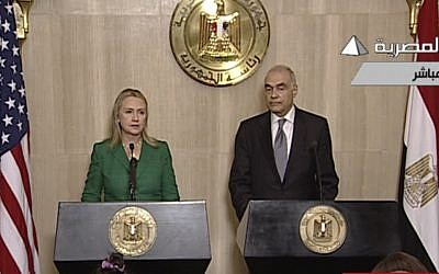 US Secretary of State Hillary Clinton, left, and Egyptian Foreign Minister Mohammed Kamel Amr give a joint news conference announcing a ceasefire between Israel and Hamas in Cairo on Wednesday (photo credit: AP/Egyptian State Television)