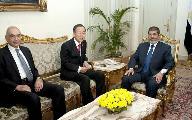 UN Secretary-General Ban Ki-moon, center, posing for photographers last November during a meeting with ousted Egyptian president Mohammed Morsi, right, in Cairo, Egypt. (photo credit: AP/Egyptian Presidency)