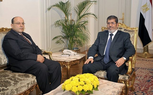 President Mohammed Morsi, right, poses for a photograph with his new Prosecutor General, Talaat Abdullah, left, in Cairo, Egypt, Thursday, Nov. 22 (photo credit: AP/Egyptian Presidency)