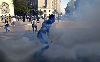 Clashes at Tahrir Square, Cairo, on Wednesday (photo credit: Khalil Hamra/AP)