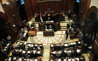 The Islamist-dominated panel vote on a final draft of a new Egyptian constitution in Cairo, Egypt, Thursday, Nov. 29 (photo credit: AP/Mohammed Asad)