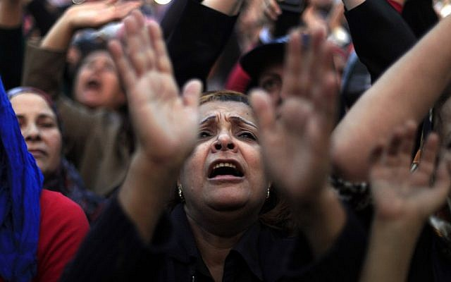 Egyptian protesters chant slogans at rally in Tahrir Square in Cairo, Egypt, Tuesday, Nov. 27, 2012 (photo credit: AP/Khalil Hamra)