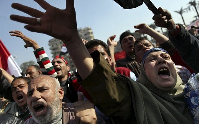 Egyptian protesters chant anti-Muslim Brotherhood slogans as they attend a rally in Tahrir Square, in Cairo, Egypt, November 2012 (photo credit: AP/Khalil Hamra)