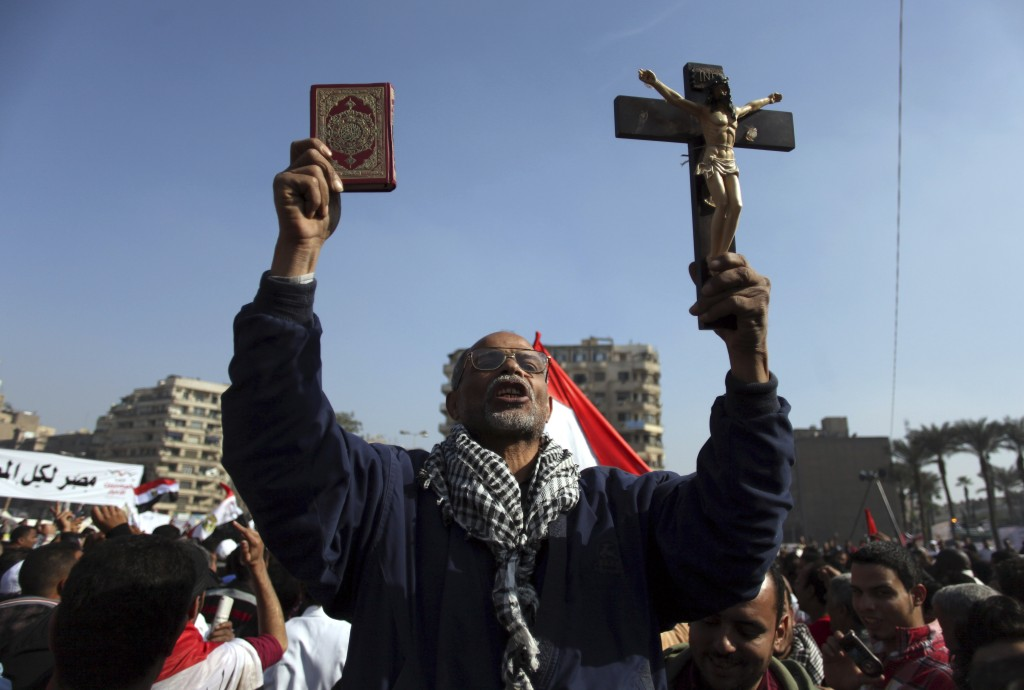 Lovely An Egyptian Protesters Holds A Cross And A Quran As He Chants Anti Muslim  Brotherhood