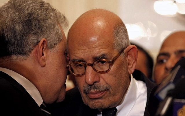 Egyptian pro-democracy figure and the former head of the International Atomic Energy Agency Mohamed ElBaradei, center, is expected to speak Friday at a rally against President Mohammed Morsi's assumption of sweeping new powers. (photo credit: AP/Mostafa El Shemy)