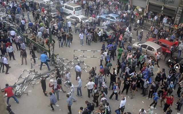 Egyptian protesters gather outside the country's high court in Cairo on Saturday. (photo credit: AP/Mohammed Asad)