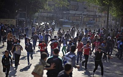 Egyptian protesters clash with security forces near Tahrir square, in Cairo, Egypt, on Wednesday, November 28, 2012 (photo credit: AP Photo/Khalil Hamra)