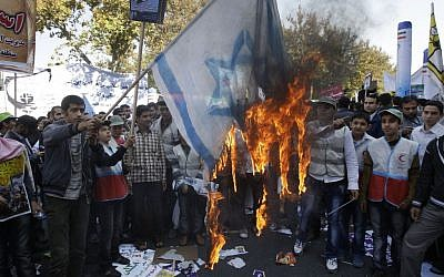 Iranians burn a representation of an Israeli flag during an annual state-backed rally outside the former US Embassy in Tehran, Iran in November 2012. (photo credit: AP)