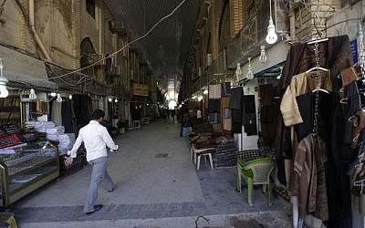 Empty shops in Najaf, Iraq, once a large draw for Iranian pilgrims. (photo credit: AP/Khalid Mohammed)