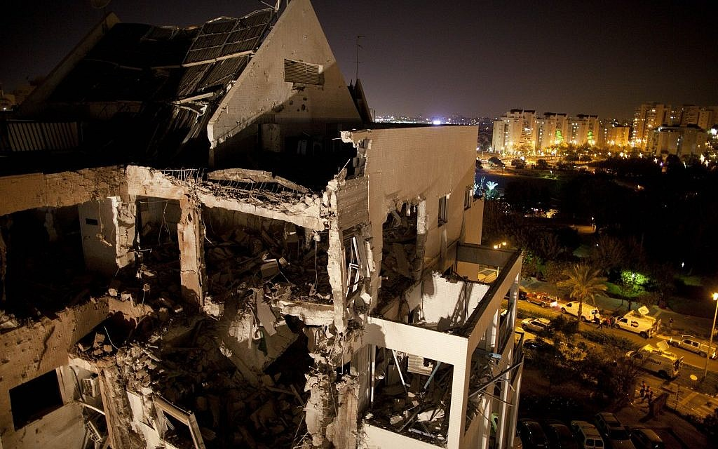 A damaged residential building in Rishon Lezion is seen after it was hit by a rocket fired by Hamas from the Gaza Strip, on Tuesday, Nov. 20, 2012. (photo credit: Oded Balilty/AP)