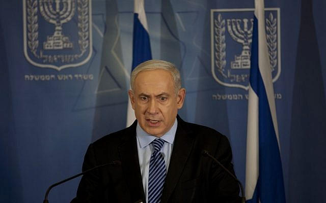 Prime Minister Benjamin Netanyahu announces operation Pillar of Defense at a press conference at the Hakirya military headquarters in Tel Aviv, Wednesday night (photo credit: AP/Ariel Schalit)