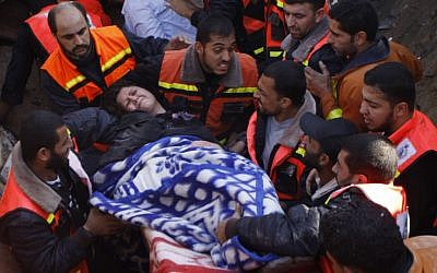 A member of the Abdel Aal family is rescued after the family house collapsed during an Israeli forces strike in the Tufah neighborhood, Gaza City, Sunday, Nov. 18, 2012. (photo credit: AP/Majed Hamdan)