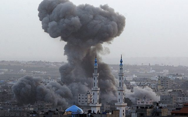Smoke rises after an Israeli air force strike in Gaza City on Saturday. (photo credit: AP/Hatem Moussa)