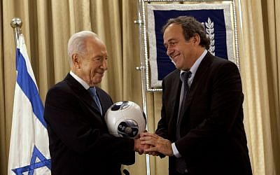 Shimon Peres (left) with Michel Platini in Jerusalem, Thursday (photo credit: Sebastian Scheiner/AP)