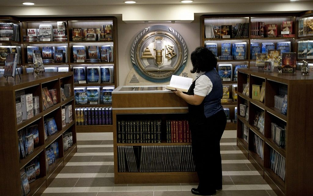 A librarian goes through books at the library of the Scientology center in the port city of Jaffa Tel Aviv, Nov. 7, 2012. (photo credit:AP/Ariel Schalit)