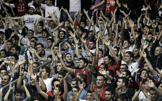 Sagesse Club fans cheer during the second half of a basketball game against Riyadi, in Ghazir north of Beirut on November 16, 2012 (photo credit: AP Photo/Bilal Hussein)