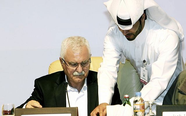 In this Nov. 11, 2012, file photo, George Sabra, the new head of the Syrian National Council, signs an agreement with the Syrian National Coalition for Opposition and Revolutionary Forces during a meeting in Doha, Qatar (photo credit: AP/Osama Faisal)