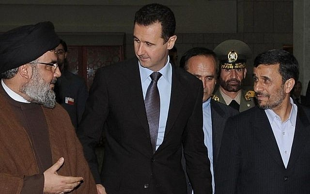In this Thursday Feb. 25, 2010 file photo, Hezbollah leader sheik Hassan Nasrallah, left, speaks with Syrian President Bashar Assad, and Iran's then-president Mahmoud Ahmadinejad upon their arrival for a dinner in Damascus, Syria. (photo credit: AP/SANA)