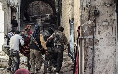 Syrian rebels in the streets of Harem (photo credit: Mustafa Karali/AP)