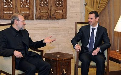 Syrian President Bashar Assad, right, meets with the speaker of the Iranian parliament, Ali Larijani, in Damascus, Syria, October 2012. (photo credit: AP/SANA)