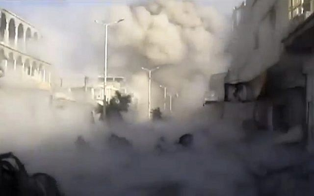 Smoke rises from the city during heavy bombing from military warplanes, in Houla, Syria, Tuesday, Nov. 6, 2012. (photo credit: Shaam News Network/AP)