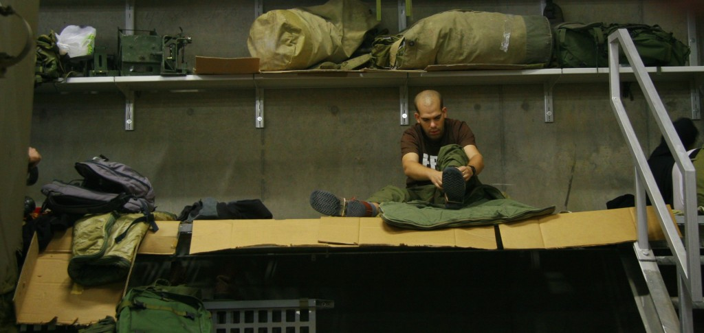 A reservist completing the transformation from civilian to soldier during the early days of Operation PIllar of Defense (Photo credit: Alon)