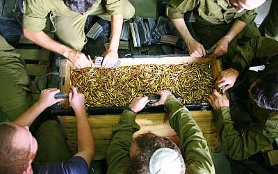 Soldiers emptying out the bullets from their magazines. (photo credit: Alon)