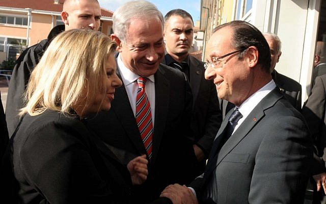 French President Francois Hollande greets Israeli Prime Minister Benjamin Netanyahu and his wife Sara at a November 2012 ceremony at the Jewish school in Toulouse where a terrorist gunman killed four in March 2012. (Avi Ohayon/GPO/Flash90/JTA)