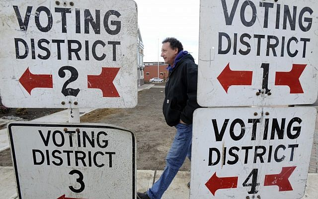 A voter heads to a polling place in New Jersey on Tuesday, Nov. 6, 2012, as Americans choose their next president. (photo credit: AP)