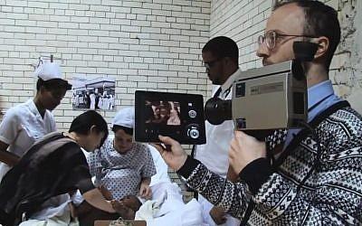 Nimrod Kamer (right) while filming the fake Barack Obama birth video (screen capture: YouTube)