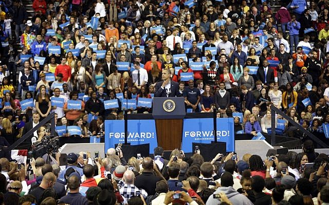 President Barack Obama begins to rub his throat while speaking to supporters during a campaign event at Fifth Third Arena in Cincinnati, Ohio on November 4. (photo credit: AP/Pablo Martinez Monsivais)