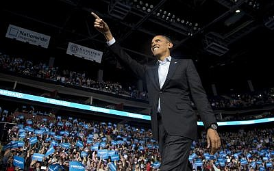 President Barack Obama points to the crowd as he arrives to speak at a campaign event at Nationwide Arena, Monday, Nov. 5, 2012, in Columbus, Ohio. (Carolyn Kaster/AP)