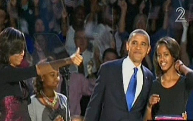 President Barack Obama and his family take the stage ahead of Obama's victory speech in Chicago on Wednesday, Nov. 7 (screen capture: Channel 2)