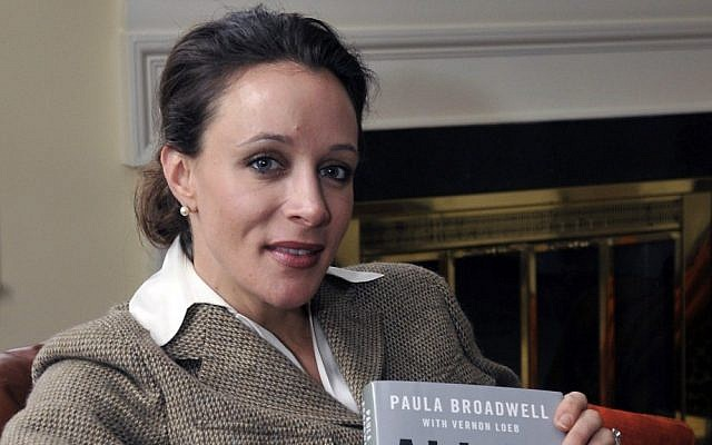 "Paula Broadwell, author of the David Petraeus biography ""All In,"" poses for photos in Charlotte, N.C. (photo credit: AP/The Charlotte Observer, T. Ortega Gaines)"