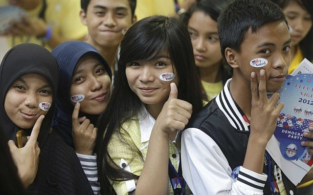 "Muslim students pose before a throng of photographers shortly after ""voting"" in the mock US election at a shopping mall at suburban Quezon city, northeast of Manila, Philippines Wednesday, Nov. 7 (photo credit: AP/Bullit Marquez)"
