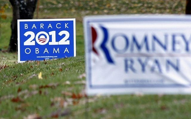 Campaign signs for both US President Barack Obama and his challenger, former Massachusetts Gov. Mitt Romney, are seen in yards outside Evans City, Pennsylvania on Friday (photo credit: AP/Keith Srakocic)